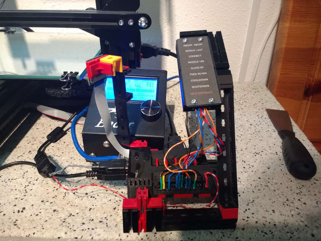 Raspberry pi with a button board next to 3D printer